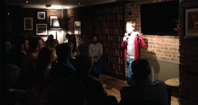 Ed Carunana performing at the Underground Comedy Club Notting Hill